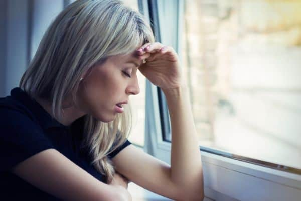 Depressed woman by the window.